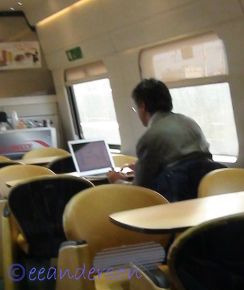 man dressed nicely on train