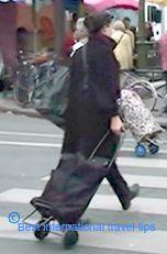 women traveling luggage